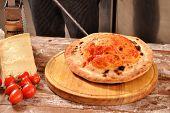 Preparing calzone pizza bread.