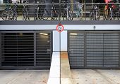 City Parkinglot Entrance With Bicycles On Top