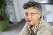 Portrait of smiling elderly woman with eyeglasses