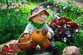 image of gnome  - Nice figure of garden gnome near house - JPG
