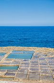 foto of gozo  - Salt evaporation ponds also called salterns or salt pans located near Qbajjar on the maltese Island of Gozo - JPG
