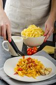 Chef Prepares Tagliatelle With Garlic And Cherry Tomatoes