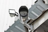 stock photo of cctv  - CCTV security camera at the wall, Security Camera