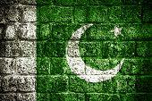 stock photo of pakistani flag  - Pakistan flag painted on old brick wall - JPG