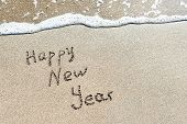 Happy New Year Caption At Beach Sand With Sea Wave Foam