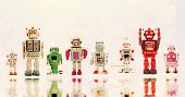 a line of retro robots