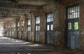 stock photo of old post office  - Old Hall of the abandoned post office with doors - JPG
