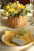 image of flower arrangement  - Festive table setting in yellow with a flower arrangement on the background - JPG