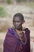 BISIL, KENYA-DECEMBER 7, 2014: Unidentified Maasai elder with traditional jewelry and piercings near the village of Bisil in southern Kenya