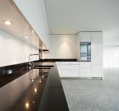 Modern architecture, wide apartment, domestic kitchen view