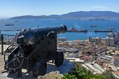 Gibraltar. Antique Cannon On A Background Of The Bay