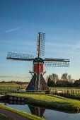 Wind mill in a dutch landscape