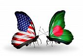 stock photo of bangladesh  - Two butterflies with flags on wings as symbol of relations USA and Bangladesh - JPG