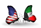 foto of kuwait  - Two butterflies with flags on wings as symbol of relations USA and Kuwait - JPG