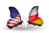 foto of south american flag  - Two butterflies with flags on wings as symbol of relations USA and South Ossetia - JPG