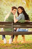 Young Smiling Couple On A Park Bench