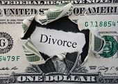stock photo of rip  - Hole ripped in a dollar bill with Divorce text - JPG