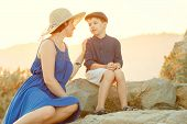 Loving mother and son outdoors on sunset