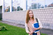 Student Standing On Building Background