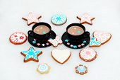 The Hand-made Eatable Gingerbread Cookies Near Cups With Cocoa And Snow Decoration