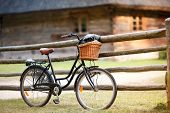 Old bicycle with basket in countryside