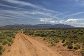 pic of four-wheel drive  - Four wheel drive trail across the desert to Moab Utah with the La Sal Mountains in the distance - JPG