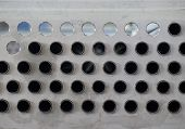 Metal Plate With Holes And Pipes