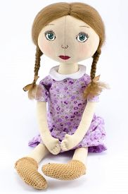 pic of rag-doll  - Rag doll in a purple dress on a white background - JPG