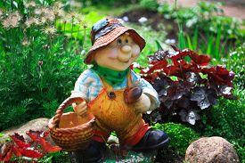 foto of gnome  - Nice figure of garden gnome near house - JPG