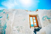 picture of abandoned house  - Old window in abandoned house with beautiful view at sea - JPG
