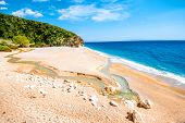 foto of albania  - Gjipe beach with rocks and river in Albania - JPG