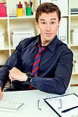foto of time study  - Surprised businessman looking at his watch at the office - JPG