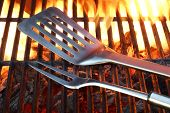 stock photo of bbq party  - BBQ Tools On The Hot Empty Clean Grill Background Close - JPG