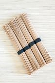 image of bundle  - upper view of four stacked bundles of Japanese buckwheat soba noodles - JPG