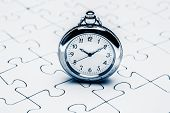 image of jigsaw  - Clock on jigsaw Jigsaw and puzzles concepts - JPG