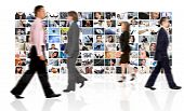 image of sult  - Business people walking by a corporate collage  - JPG