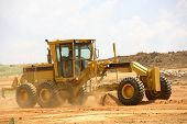 picture of road construction  - Grader clearing a construction site for a new road - JPG