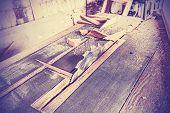 foto of sawing  - Vintage stylized circular saw in old carpenter - JPG