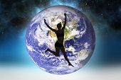 foto of starry night  - Full length of a sporty young woman jumping against starry night sky - JPG