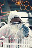 image of protective eyewear  - Science and medical graphic against portrait of a protected science student looking at a test tube - JPG