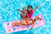 stock photo of swimming  - Family with children in swimming pool - JPG