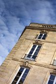 stock photo of mansion  - Facade of an old stylish stoned mansion at Bordeaux France - JPG