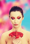 foto of lilly  - Young woman with red lilly flower - JPG