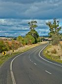 Bend in the Road in the Australian Bush with Storm Clouds Threatenning