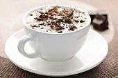 stock photo of hot-chocolate  - Cup of hot cocoa with shaved chocolate and whipped cream - JPG