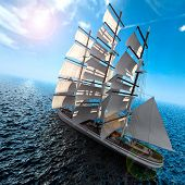 stock photo of sloop  - Sailing ship in the vast ocean with small waves is getting all the sails filled with sea breeze - JPG