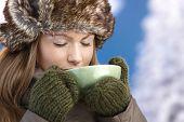 Young Female Dressed Up Warm Enjoying Hot Tea