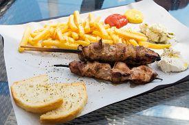 pic of souvlaki  - Souvlaki portion on a table in a restaurant - JPG