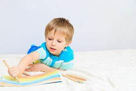 pic of daycare  - little boy drawing - JPG