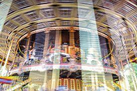 stock photo of merry-go-round  - Motion blurr of vintage merry go round carousel - JPG